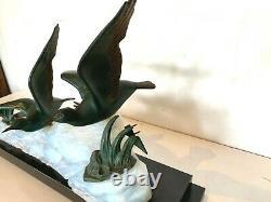 Lampe Art Déco Régule et verre opalin Socle en marbre XX siècle